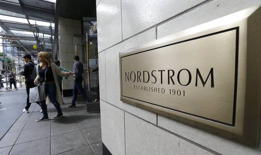 In this Wednesday, Sept. 13, 2017, photo, shoppers come and go from Nordstrom Inc.'s flagship store in downtown Seattle. Nordstrom, Inc. reports earnings Thursday, Nov. 9, 2017.