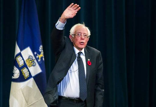 "United States Sen. Bernie Sanders waves after speaking at the University of Toronto during an event called ""What the U.S. Can Learn from Canadian Health Care,"" in Toronto, Sunday, Oct. 29, 2017. (Mark Blinch/The Canadian Press via AP)"