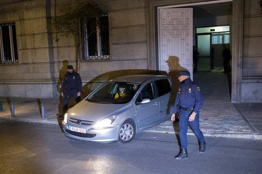 Catalonia parliament speaker Carme Forcadell is driven in a car outside of the Spain's Supreme Court in Madrid, Thursday, Nov. 9, 2017. A Spanish judge jailed Catalonia's top lawmaker Thursday in a rebellion probe stemming from an independence declaration, but set Carme Forcadell's bail at 150,000 euros ($175,000) and ordered her passport to be confiscated as the investigation continues. (AP Photo/Francisco Seco)