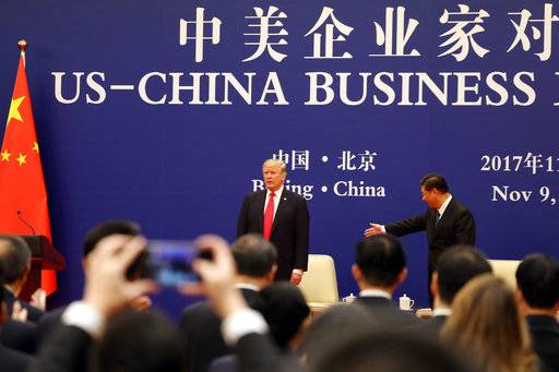 U.S. President Donald Trump, center left, and Chinese President Xi Jinping, center right, attend a business event at the Great Hall of the People in Beijing, Thursday, Nov. 9, 2017.
