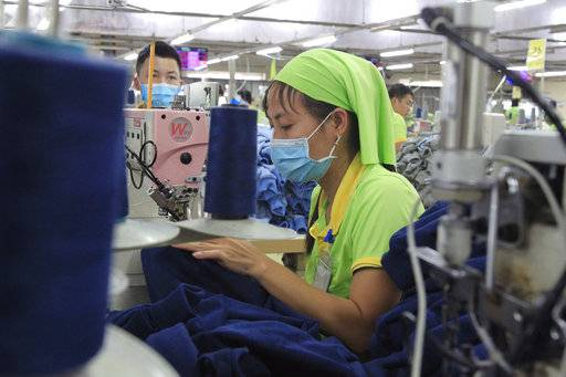 In this Oct. 24, 2017, photo, a garment worker sews clothes at Pro Sports factory in Nam Dinh province, Vietnam. U.S. President Donald Trump's decision to withdraw from a far-reaching Pacific Rim trade pact is having scant impact on fast-growing trade in the region.