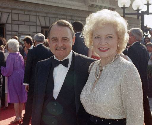 "FILE- This Sept. 22, 1985, file photo shows John Hillerman, left, and Betty White, right, arriving at Emmy Awards in Pasadena, Calif. A spokeswoman for the family of Hillerman says the co-star of TV's ""Magnum, P.I.� has died. Hillerman was 84. Spokeswoman Lori De Waal said Hillerman died Thursday at his home in Houston. She said the cause of death has yet to be determined. (AP Photo/LIU, File)"
