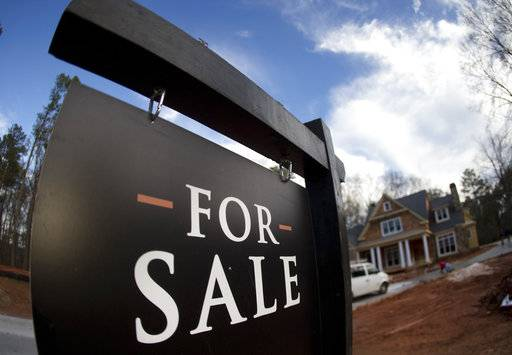 FILE - In this Thursday, Dec. 3, 2015, file photo, a home under construction and for sale is shown in Roswell, Ga. On Thursday, Nov. 9, 2017, Freddie Mac reports on the week's average U.S. mortgage rates. (AP Photo/John Bazemore, File)