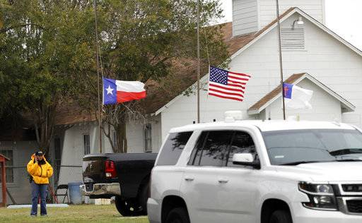A law enforcement official continues to work the shooting scene at the First Baptist Church Wednesday, Nov. 8, 2017, in Sutherland Springs, Texas. A man opened fire inside the church in the small South Texas community on Sunday, killing more than two dozen and injuring others.