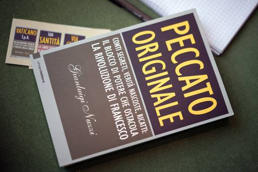 "A copy of journalist Gianluigi Nuzzi's latest book ""Peccato Originale"" (Original Sin) is seen during a press conference to present it, in Rome, Thursday, Nov. 9, 2017."