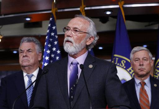 Rep. Dan Newhouse, R-Wash., center, flanked by Rep. Peter King, R-N.Y., left, and Rep. Fred Upton, R-Mich., join a group of Republican lawmakers to encourage support for the Deferred Action for Childhood Arrivals (DACA) program​, during a news conference on Capitol Hill in Washington, Thursday, Nov. 9, 2017.