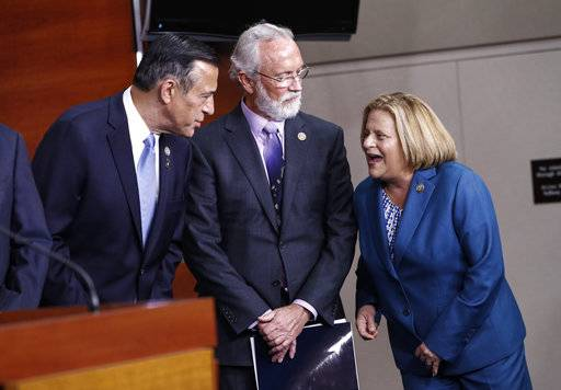 From left, Rep. Darrell Issa, R-Calif., Rep. Dan Newhouse, R-Wash., and Rep. Ileana Ros-Lehtinen, R-Fla., confer during a news conference on GOP support for the Deferred Action for Childhood Arrivals (DACA) program​, on Capitol Hill in Washington, Thursday, Nov. 9, 2017.