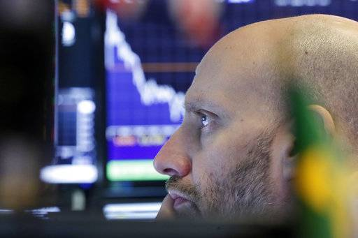 Specialist Meric Greenbaum studies his screens as he works at his post on the floor of the New York Stock Exchange, Thursday, Nov. 9, 2017. U.S. stocks are sinking Thursday morning as technology companies and most other parts of the market take sharp losses.