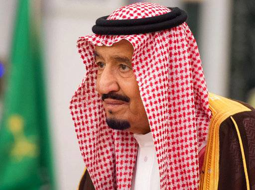 In this photo provided by the Saudi Press Agency, King Salman attends a swearing in ceremony in Riyadh, Saudi Arabia, Monday, Nov. 6, 2017. The king has sworn in new officials to take over from a powerful prince and former minister believed to be detained in a large-scale sweep that has shocked the country and upended longstanding traditions within the ruling family. (Saudi Press Agency, via AP)