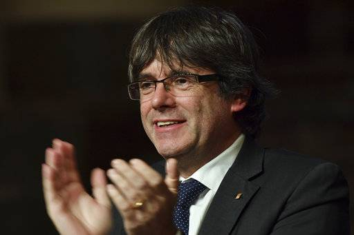 Ousted Catalan leader Carles Puigdemont applauds Catalan mayors who travelled to Brussels to take part in an event in support of the ousted Catalan government in Brussels, Belgium on Tuesday, Nov. 7, 2017. Puigdemont is fighting extradition to Spain, where other members of the ousted Cabinet have been sent to jail while awaiting the results of a probe for allegedly weaving a strategy to secede from Spain.