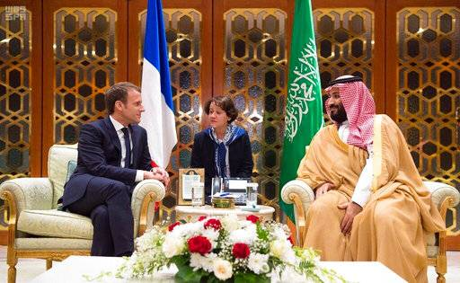 In this Thursday, Nov. 9, 2017, photo released by Saudi Press Agency, SPA, Saudi Crown Prince Mohammed bin Salman, right, meets with French President Emmanuel Macron upon his arrival in Riyadh, Saudi Arabia. (Saudi Press Agency via AP)