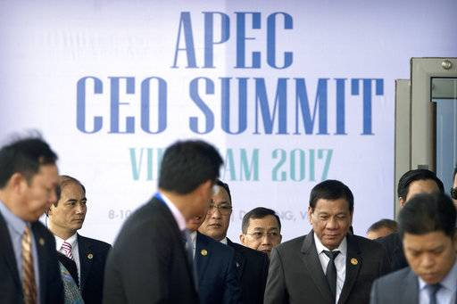 Philippine President Rodrigo Duterte, right, leaves the Asia-Pacific Economic Cooperation (APEC) CEO Summit in Danang, Vietnam, Thursday, Nov. 9, 2017. Talks aimed at salvaging a Pacific Rim trade pact rejected by President Donald Trump resumed Thursday on the sidelines of the annual summit of the Asia-Pacific Economic Cooperation forum. (AP Photo/Mark Schiefelbein)