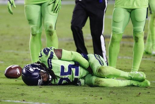 Seattle Seahawks cornerback Richard Sherman (25) lies injured on the turf after tackling Arizona Cardinals wide receiver John Brown (12) during the second half of an NFL football game, Thursday, Nov. 9, 2017, in Glendale, Ariz. Sherman did not return to the game after the injury. (AP Photo/Rick Scuteri)
