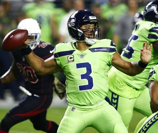 Seattle Seahawks quarterback Russell Wilson (3) throws against the Arizona Cardinals during the first half of an NFL football game, Thursday, Nov. 9, 2017, in Glendale, Ariz.