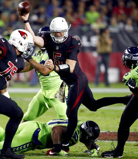 Arizona Cardinals quarterback Drew Stanton (5) gets off the pass against the Seattle Seahawks during the first half of an NFL football game, Thursday, Nov. 9, 2017, in Glendale, Ariz. The Cardinals maintained possession.
