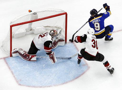 St. Louis Blues' Scottie Upshall (9) is unable to score past Arizona Coyotes goalie Antti Raanta, of Finland, and Coyotes' Christian Fischer (36) during the second period of an NHL hockey game Thursday, Nov. 9, 2017, in St. Louis.