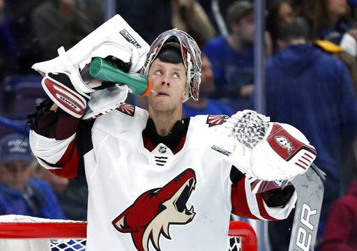 Arizona Coyotes goalie Antti Raanta, of Finland, looks toward the scoreboard after giving up a goal to St. Louis Blues' Joel Edmundson during the second period of an NHL hockey game Thursday, Nov. 9, 2017, in St. Louis.