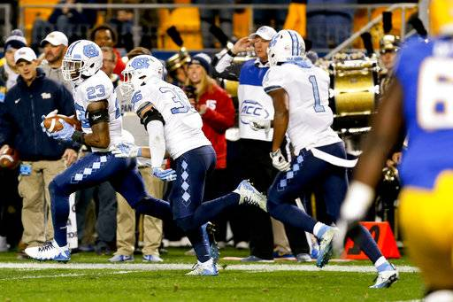 North Carolina linebacker Cayson Collins (23) runs with the ball ahead of teammates after recovering a fumble near the goal line by Pittsburgh wide receiver Quadree Henderson during the second quarter of an NCAA college football game, Thursday, Nov. 9, 2017, in Pittsburgh.