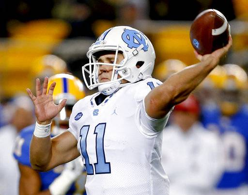 North Carolina quarterback Nathan Elliott throws a pass asNorth Carolina safety Myles Wolfolk, left rear, pursues during the second quarter of an NCAA college football game, Thursday, Nov. 9, 2017, in Pittsburgh.