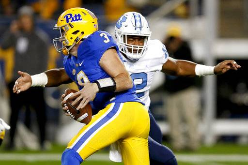 North Carolina defensive end Tomon Fox (12) sacks Pittsburgh quarterback Ben Dinucci (3) during the first quarter of an NCAA college football game, Thursday, Nov. 9, 2017, in Pittsburgh.