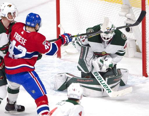 Montreal Canadiens center Byron Froese (42) is stopped by Minnesota Wild goalie Devan Dubnyk (40) during the second period of an NHL hockey game Thursday, Nov. 9, 2017, in Montreal. (Ryan Remiorz/The Canadian Press via AP)