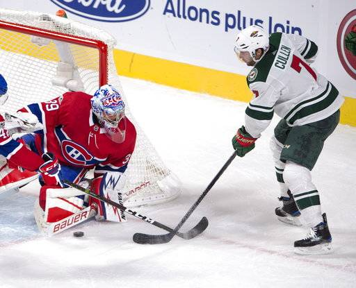 Montreal Canadiens goalie Charlie Lindgren (39) stops Minnesota Wild center Matt Cullen (7) during the first period of an NHL hockey game Thursday, Nov. 9, 2017, in Montreal. (Ryan Remiorz/The Canadian Press via AP)