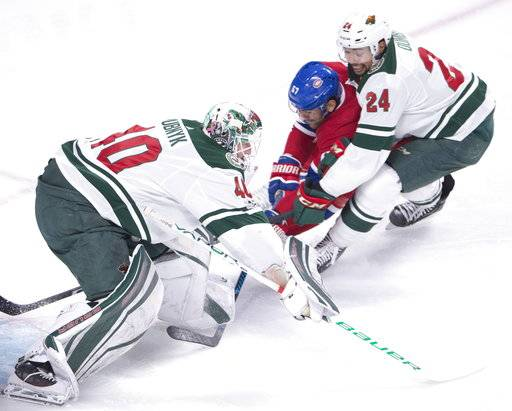 Montreal Canadiens left wing Max Pacioretty (67) is stopped by Minnesota Wild goalie Devan Dubnyk (40) and Wild's Matt Dumba (24) during the first period of an NHL hockey game Thursday, Nov. 9, 2017, in Montreal. (Ryan Remiorz/The Canadian Press via AP)
