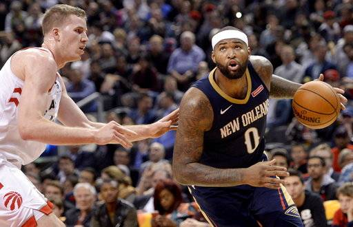 New Orleans Pelicans center DeMarcus Cousins (0) looks to drive the ball past Toronto Raptors center Jakob Poeltl (42) during the second half of an NBA basketball game Thursday, Nov. 9, 2017, in Toronto. (Nathan Denette/The Canadian Press via AP)