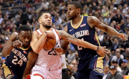 Toronto Raptors guard Fred VanVleet (23) drives past New Orleans Pelicans forward Darius Miller (21) and guard Tony Allen (24) during the first half of an NBA basketball game Thursday, Nov. 9, 2017, in Toronto. (Nathan Denette/The Canadian Press via AP)