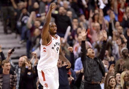 Fans react after Toronto Raptors forward Serge Ibaka (9) sank a basket against the New Orleans Pelicans during the second half of an NBA basketball game Thursday, Nov. 9, 2017, in Toronto. (Nathan Denette/The Canadian Press via AP)
