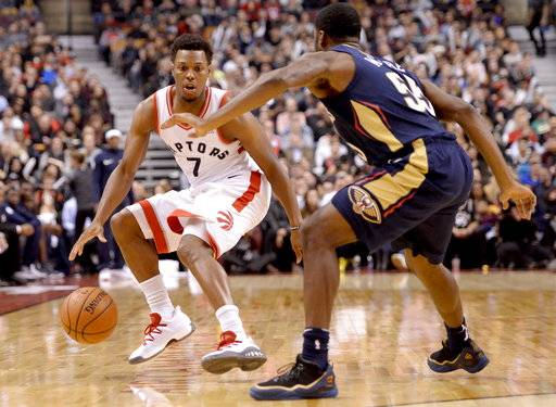 Toronto Raptors guard Kyle Lowry (7) looks to make his way around New Orleans Pelicans guard E'Twaun Moore (55) during the first half of an NBA basketball game Thursday, Nov. 9, 2017, in Toronto. (Nathan Denette/The Canadian Press via AP)