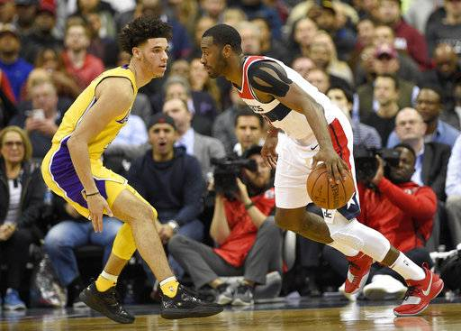 Washington Wizards guard John Wall, right, dribbles against Los Angeles Lakers guard Lonzo Ball during the first half of an NBA basketball game, Thursday, Nov. 9, 2017, in Washington. (AP Photo/Nick Wass)