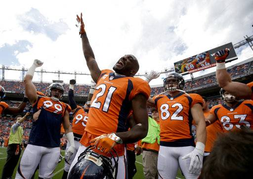 FILE - In this Oct. 1, 2017, file photo, Denver Broncos cornerback Aqib Talib cheers before the team's NFL football game against the Oakland Raiders in Denver. The typically talkative Talib has been noticeably silent all week at practice. Not that much for the cornerback to say after an abysmal performance by a usually dependable Denver Broncos defense. The Broncos host New England on Sunday night. (AP Photo/Jack Dempsey, File)