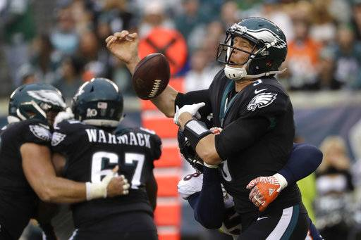 Philadelphia Eagles' Nick Foles (9) fumbles the ball as he is hit by Denver Broncos' Von Miller (58) during the second half of an NFL football game, Sunday, Nov. 5, 2017, in Philadelphia.
