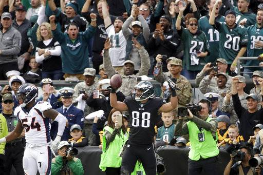 Philadelphia Eagles' Trey Burton (88) celebrates after scoring a touchdown past Denver Broncos' Brandon Marshall (54) during the first half of an NFL football game Sunday, Nov. 5, 2017, in Philadelphia.
