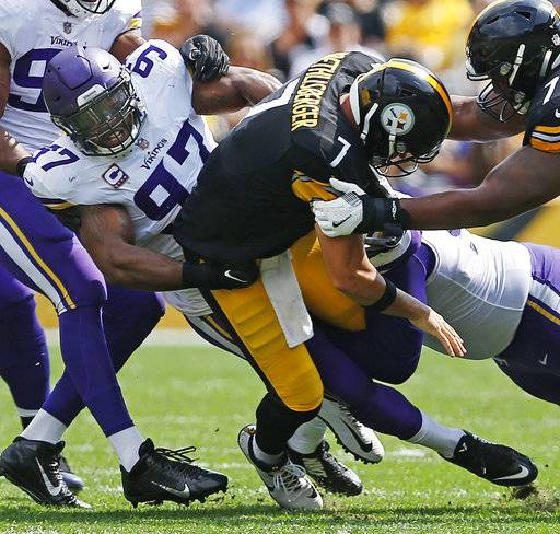 "FILE - In this Sept. 17, 2017, file photo, Pittsburgh Steelers quarterback Ben Roethlisberger (7) is sacked by Minnesota Vikings defensive end Everson Griffen (97) during the first half of an NFL football game, in Pittsburgh. The Vikings defensive end joined stud pass-rushers Dwight Freeney and Robert Mathis as the only three players with a sack in each of his first eight games of the season since the league began tracking the stat in 1982. Griffen talks like a chunk of his 10 sacks belong to fellow linemen Daniell Hunter, Brian Robison, Tom Johnson and Linval Joseph. ""I can't do it without my defensive line,� Griffen said. (AP Photo/Keith Srakocic, File)"