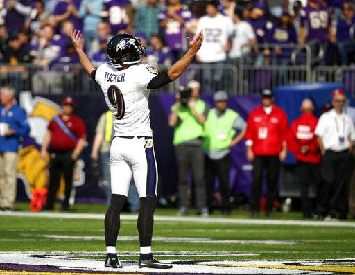 FILE - In this Oct. 22, 2017, file photo, Baltimore Ravens kicker Justin Tucker (9) celebrates after kicking a 57-yard field goal during the first half of an NFL football game against the Minnesota Vikings, in Minneapolis. NFL kickers are thriving as much as ever. Ten of them are making 90 percent or more of their field goals, with 50-plus-yarders becoming more and more routine.