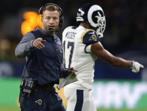 FILE - In this Oct. 22, 2017, file photo, Los Angeles Rams head coach Sean McVay walks on the field during the first half of an NFL football game against Arizona Cardinals at Twickenham Stadium in London. Coach of the year often winds up in the hands of someone who has turned around the fortunes of his team. That would put first-year head coach Sean McVay of the Rams, Philadelphia's Doug Peterson and Buffalo's Sean McDermott, also a rookie, as the front runners. (AP Photo/Tim Ireland, File)