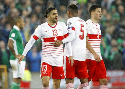 Switzerland's Ricardo Rodriguez celebrates with teammates after the World Cup qualifying play-off first leg soccer match between Northern Ireland and Switzerland at Windsor Park in Belfast, Northern Ireland, Thursday Nov. 9, 2017.