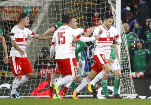 Switzerland's Ricardo Rodriguez, right, celebrates after scoring the opening goal from the penalty spot during the World Cup qualifying play-off first leg soccer match between Northern Ireland and Switzerland at Windsor Park in Belfast, Northern Ireland, Thursday Nov. 9, 2017.