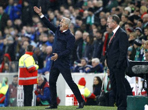 Switzerland manager Vladimir Petkovic, left, gestures during the World Cup qualifying play-off first leg soccer match between Northern Ireland and Switzerland at Windsor Park in Belfast, Northern Ireland, Thursday Nov. 9, 2017.