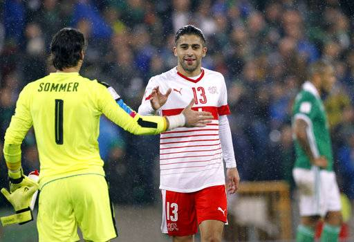 Switzerland's Yann Sommer greets Ricardo Rodriguez after the World Cup qualifying play-off first leg soccer match between Northern Ireland and Switzerland at Windsor Park in Belfast, Northern Ireland, Thursday Nov. 9, 2017.