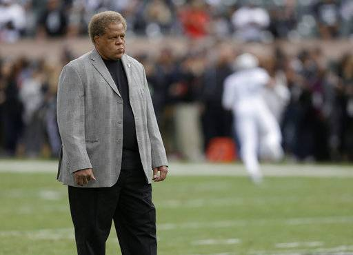 FILE - In this Oct. 19, 2017, file photo, Oakland Raiders general manager Reggie McKenzie stands on the field before the team's NFL football game against the Kansas City Chiefs in Oakland, Calif. Smart draft picks by McKenzie were the key for the Raiders' transformation from a team that failed to produce a winning record for 13 years to one that won 12 games a year ago and was considered a top contender in the AFC this season. A lack of contributions from the past two draft classes are a major reason why the Raiders (4-5) have been a major disappointment this season and head into their bye week barely holding on to playoff hopes. (AP Photo/Ben Margot, File)
