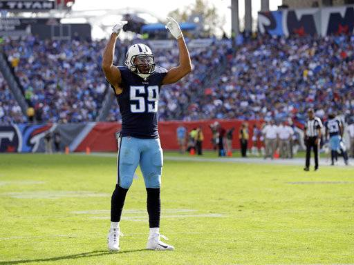 FILE - In this Nov. 5, 2017 file photo, Tennessee Titans inside linebacker Wesley Woodyard gestures to the crowd during the first half of an NFL football game between the Titans and the Baltimore Ravens in Nashville, Tenn. Woodyard is having such a strong season at linebacker for Tennessee that the Titans are having a hard time taking him off the field with Cincinnati up next. (AP Photo/James Kenney, File)