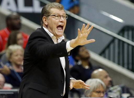 FILE - In this March 31, 2017, file photo, Connecticut head coach Geno Auriemma directs his players during an NCAA college basketball game against Mississippi State in the semifinals of the women's Final Four NCAA college basketball tournament in Dallas. The Huskies saw their 111-game winning streak end on a last-second overtime loss to Mississippi State. They are hungry and with the longest winning streak in NCAA history behind them, ready to try and win a fifth national championship in the past six seasons.
