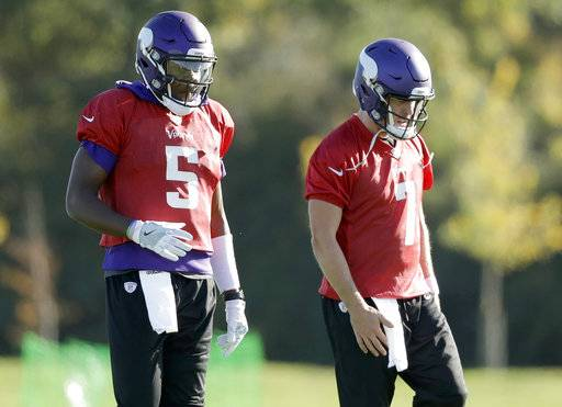 FILE - In this Oct. 27, 2017, file photo, Minnesota Vikings quarterbacks Teddy Bridgewater, left, and Case Keenum take part in an NFL football training session at the London Irish rugby team training ground in the Sunbury-on-Thames suburb of south west London. The Vikings have taken Bridgewater off the physically unable to perform list on Wednesday, Nov. 8, 2017, adding him to the active roster for the first time since he badly injured his left knee during practice more than 14 months ago. (AP Photo/Matt Dunham, File)