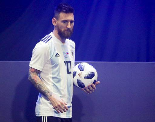 Argentinian national soccer team striker Lionel Messi poses with the official match ball for the 2018 FIFA World Cup Russia, named Telstar 18, during the unveiling ceremony in Moscow, Russia, Thursday, Nov. 9, 2017. The Telstar 18 has a retro black-and-white design harking back to the original Adidas Telstar ball used for the 1970 World Cup, and Adidas says that in terms of structure, it's an evolution of the ball used for the last World Cup in 2014. (Oleg Shalmer)