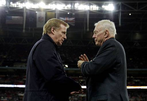 "FILE - In this Nov. 9, 2014, file photo, NFL commissioner Roger Goodell, left, and Dallas Cowboys owner Jerry Jones talk during an NFL football game between the Jacksonville Jaguars and Cowboys at Wembley Stadium in London. The NFL expects a five-year contract extension with Commissioner Roger Goodell to be finalized soon, despite a threatened lawsuit by Dallas Cowboys owner Jerry Jones. NFL spokesman Joe Lockhart said Thursday, Nov. 9, 2017, that ""our expectation is this will be wrapped up soon, but we can't project an actual date.�"
