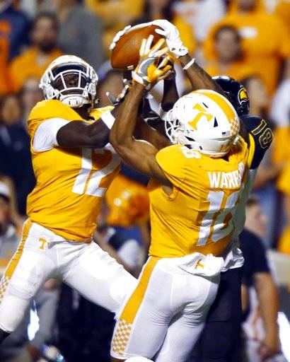 FILE -- In this Nov. 4, 2017 file photo, Tennessee defensive back Emmanuel Moseley (12) and defensive back Nigel Warrior (18) break up a pass intended for Southern Mississippi wide receiver Korey Robertson (18) in an NCAA college football game in Knoxville, Tenn. Tennessee has allowed just 150 yards passing per game to rank fourth nationally, but the Volunteers aren't sure exactly how strong their pass defense is because teams don't throw against them very often. The Vols should learn whether their pass defense is as good as its ranking Saturday when they face Missouri's Drew Lock, whose 31 touchdown passes lead the nation. (AP Photo/Wade Payne, File)