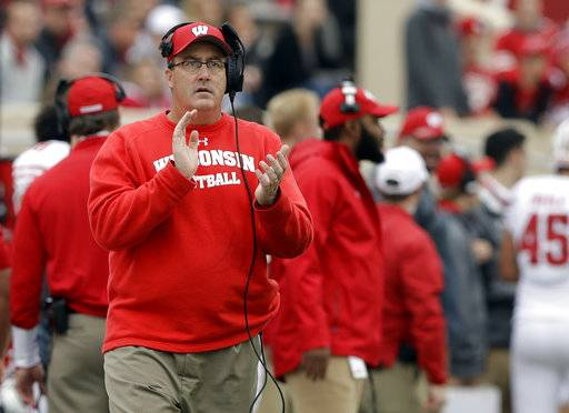FILE - In this Nov. 4, 2017, file photo, Wisconsin head coach Paul Chryst watches during the second half of an NCAA college football game against Indiana in Bloomington, Ind. The Big Ten may not have a team in the College Football Playoff for the first time since it started in 2014. No. 6 Wisconsin, the leader in the West Division, is 9-0 and still very much a playoff contender. But the playoff selection committee has the Badgers ranked eighth because of a resume light on marquee victories.